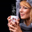 Beautiful blonde woman with cup — Stock Photo #24115753