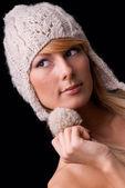 Beautiful girl wearing knitted hat — Stock Photo