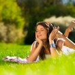 Beautiful Young Woman with Headphones Outdoors — Стоковое фото