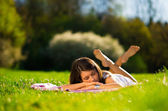 Young Woman sleep on beautiful green grass — Stock Photo