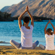Mother and daughter doing yoga — Stock Photo #31008781