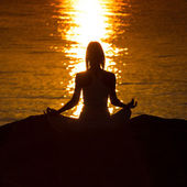 Silhouette of a woman doing yoga — Stock Photo