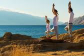 Family doing yoga exercise — Stock Photo