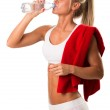 Girl drinking water after training — Stock Photo