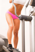 Young woman using an exercise step machine — Stock Photo