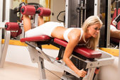 Young women training weights with legs — Stock Photo