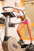 Young woman using a step machine — Stock Photo