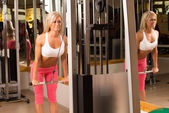 Woman doing weight training — Stock Photo