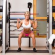 Woman lifts dumbbells — Stock Photo
