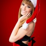 Ritratto di una bella ragazza sexy, indossando abiti di Babbo Natale — Foto Stock