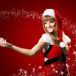 Portrait of beautiful sexy girl wearing santa claus — Stock Photo #32312609