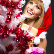 Portrait of young, sexy woman Santa with gift boxes — Stock Photo