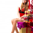Portrait of young, sexy female Santa isolated on white — Stock Photo #32312681