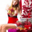 Portrait of young, sexy female Santa isolated on white — Stock Photo #32312687
