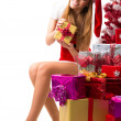 Portrait of young, sexy female Santa isolated on white — Stock Photo