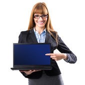 Business woman presenting a laptop — Stock Photo