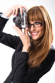 Business woman holding old camera — Stockfoto