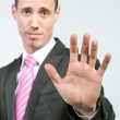 Businessman showing STOP — Stock Photo