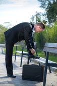 Businessman tie his shoelace — Stock Photo
