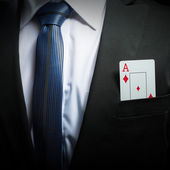 Ace card in suit pocket — Stock Photo