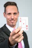 Businessman holding ace cards — Stock Photo