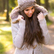 Beautiful girl in the autumn park — Stock Photo #33758809