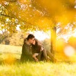Passionate kissing in the park under a tree — Stock Photo #33759097