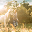 Girl with a horse — Stock Photo #34144551