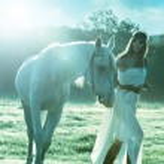 Women with white horse — Stock Photo