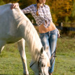 Stock Photo: White horse and woman