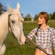 White horse and woman — Stock Photo