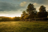 Beautiful sunrise on the farm — Stock Photo