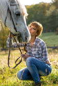 Women with white horse — Stock Photo