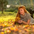 Woman in the autumn leaves — Stock Photo #34864139