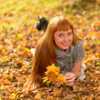 Stock Photo: Woman in the autumn leaves