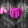 Ballet clothes, accessories on a clothesline — Stock Photo