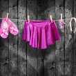 Stock Photo: Ballet clothes, accessories on clothesline