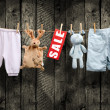 Stock Photo: Clean baby girl clothes on the clothesline - SALE