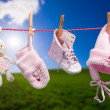 Baby clothes on the clothesline in outdoor — Stock Photo