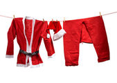 Santa Claus clothes on the clothesline — Stock Photo