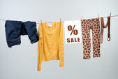 Women's fashion discount on the clothesline — Stock Photo