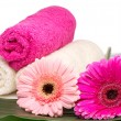 Spa still life with aromatic candles, flower and towel — Стоковая фотография