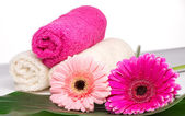 Spa still life with aromatic candles, flower and towel — Stock Photo