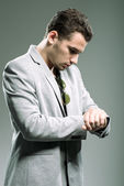 Businessman looking at his watch — Stock Photo