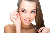 Woman using mascara — Stock Photo