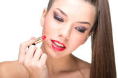 Woman using a red lipstick — Stock Photo