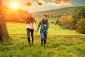 Young couple running on the beautiful scenery — Stock Photo