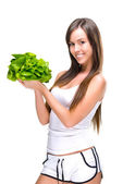 Healthful eating-Beautiful fit woman holding a salad. — Stock Photo