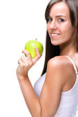 Healthful eating-Beautiful natural woman holds an apple — Stock Photo