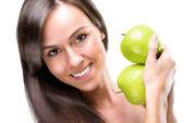 Healthful eating-Beautiful woman holding apples, close-up photo — Stockfoto